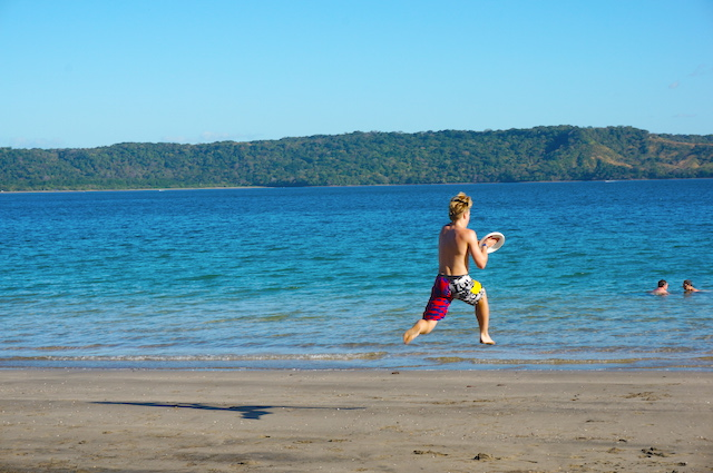 Kyle catching a frisbee in Costa Rica