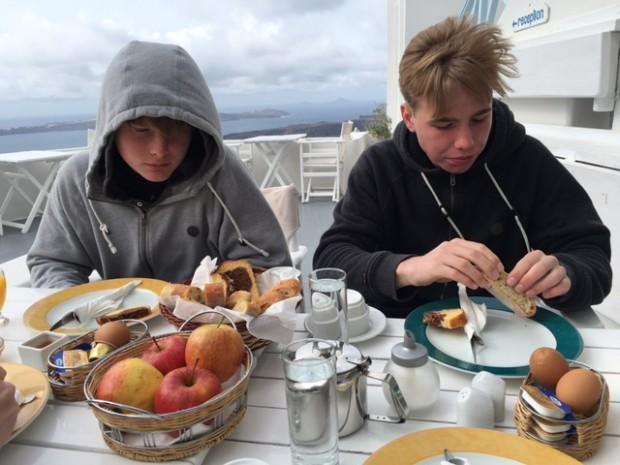 Breakfast outside in the cold rain. Santorini, Greece