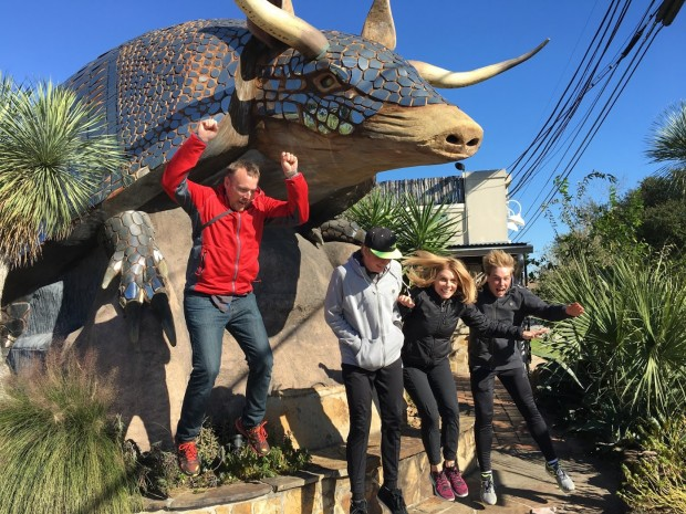 Jumping off of a giant metal armadillo at the Armadillo Palace, Houston, Texas