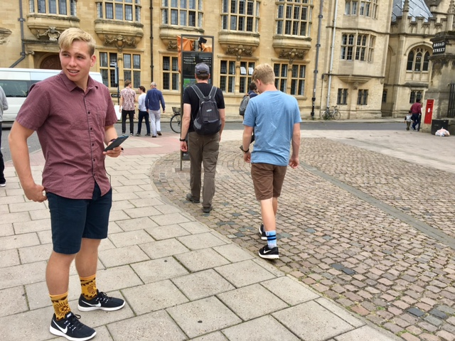 "Kyle finishing his Pokemon RAID Battle with Eli and Dave walking ahead to the next ""nuisance"" landmark, Oxford, England"